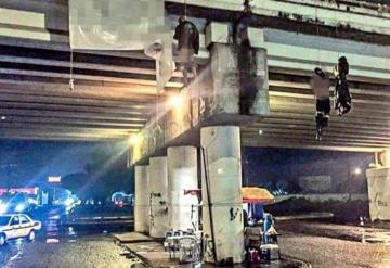 Identifican a 13 de los 19 asesinados y colgados en puente en Uruapan