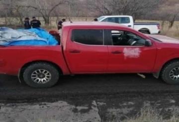Hallan 12 cuerpos abandonados en una camioneta en Michoacán