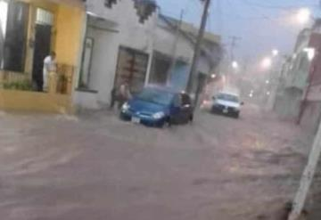 Lluvia inunda calles de Teapa